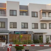 La façade et le parking privé du Garden Square